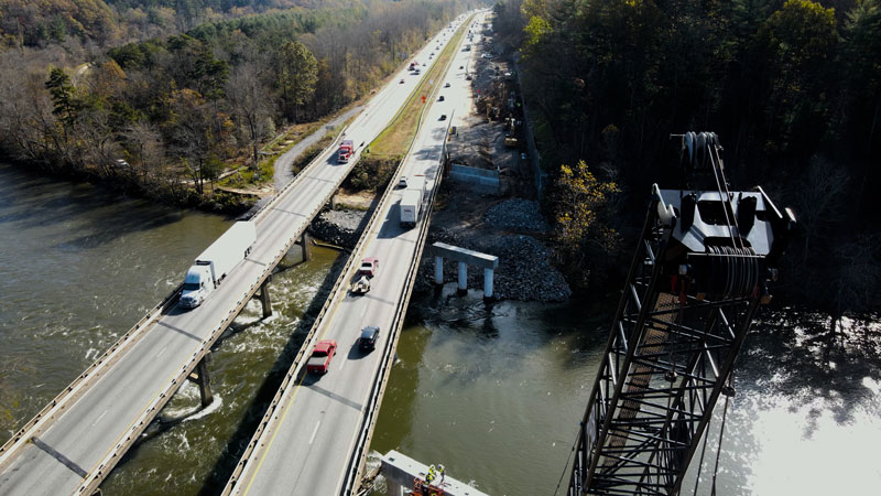 drone flying over road construction site