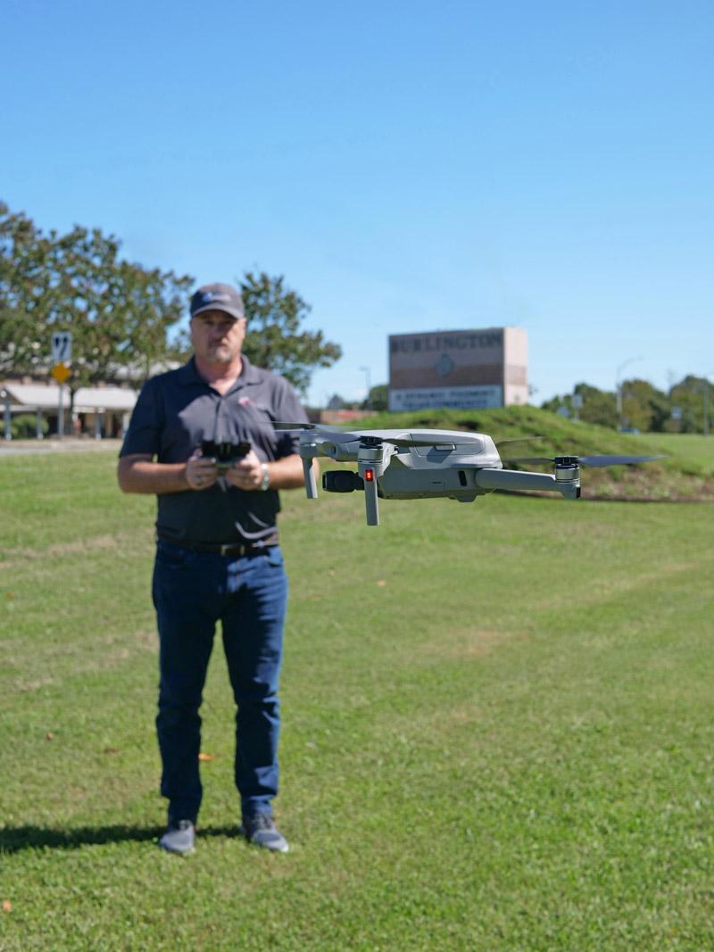 Ken Morrison flying a drone